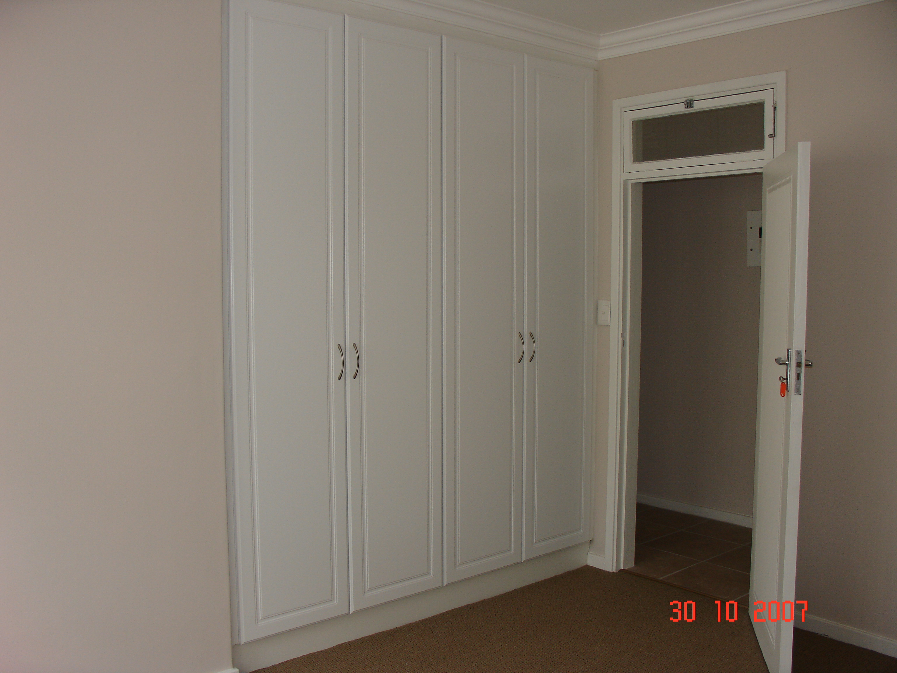 Two White Melamine Built In Cupboards Nicos Kitchens