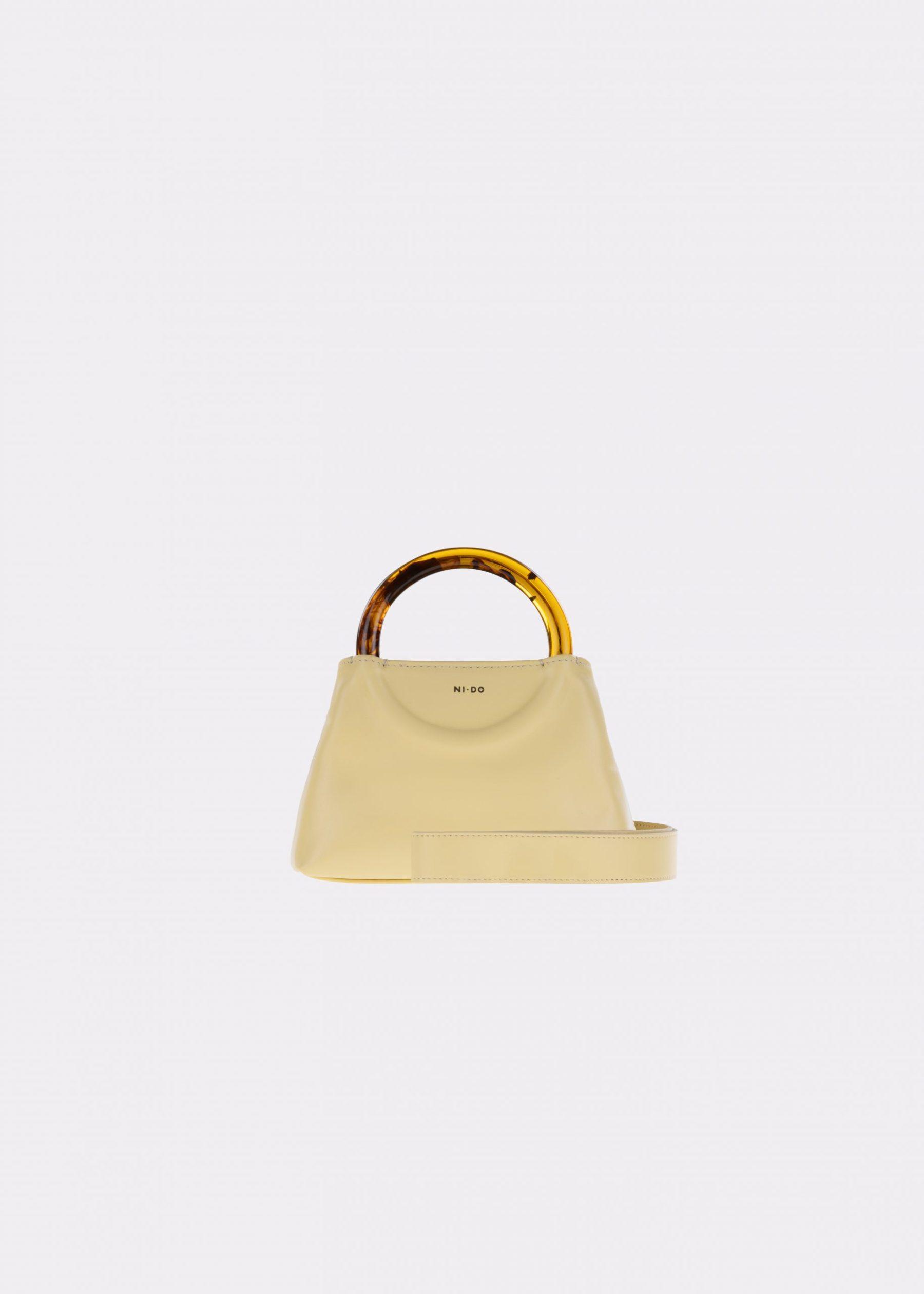 NIDO-Bolla_Micro-bag-lemontart-Amber_shoulderstrap view