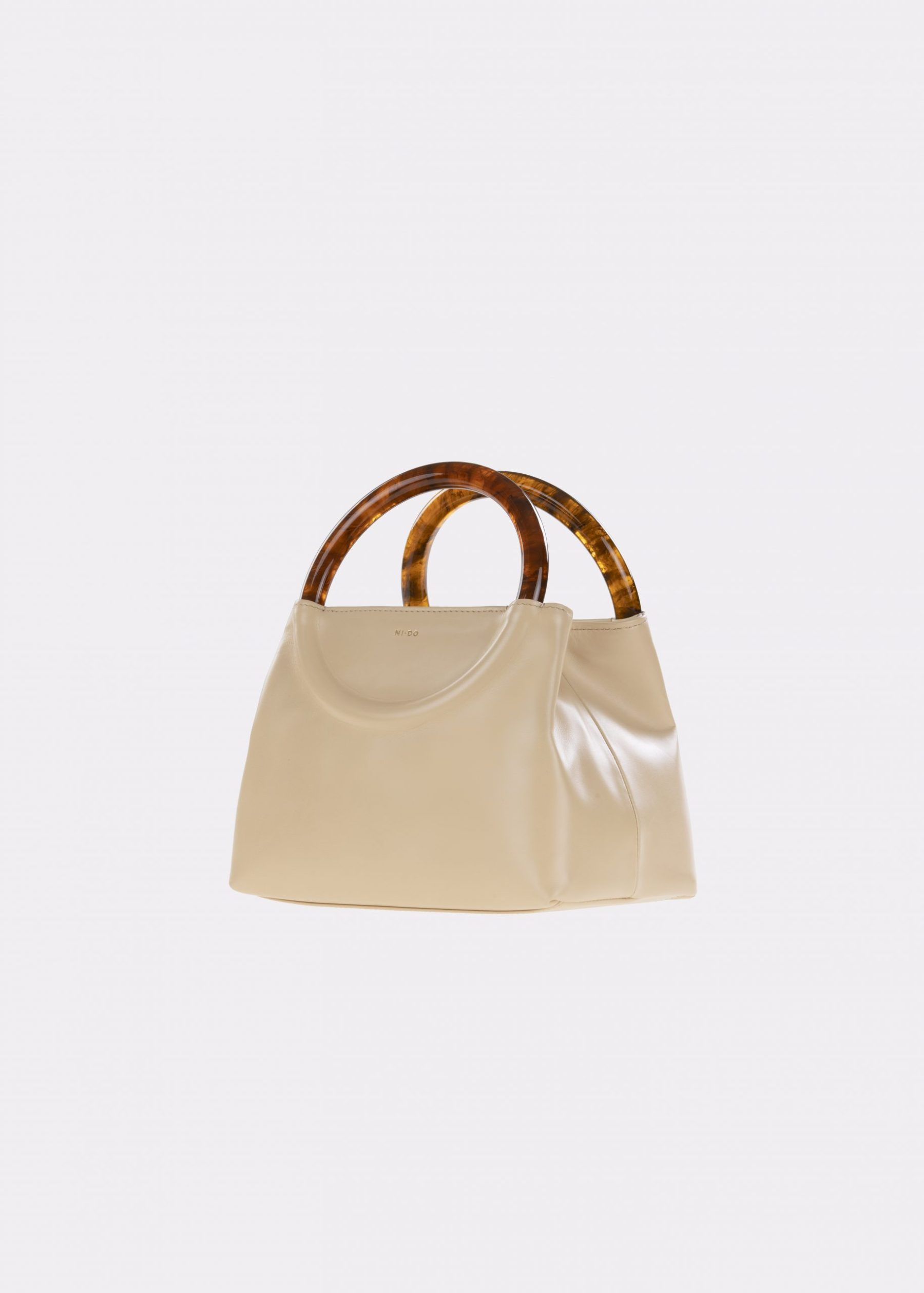 NIDO-Bolla_Mini-bag-Peanut-Amber_sideview