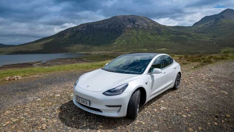 Telsa Model 3 in Scottish Highlands