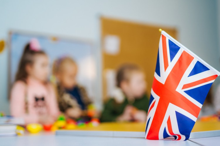 Learn English. School Children. Education in the United Kingdom. Flag of Great Britain.