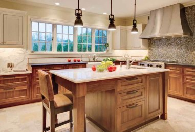 Above: Designer Liz Murray custom-designed the kitchen cabinetry, made by Big Branch Woodworking. Marble with a bronze inlay forms the backsplash, and a mosaic from Hakatai lies below the Vent-A-Hood fixture; appliances are from BASCO.