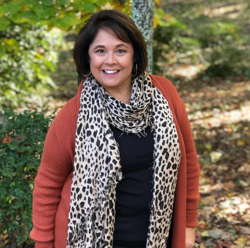 Add a leopard print scarf to create fun fall outfit