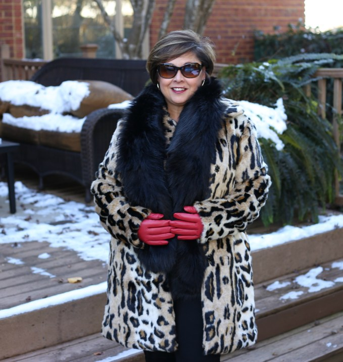 faux fur coat with red leather gloves