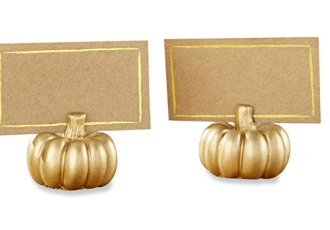 How To Create A Picture Perfect Thanksgiving Table-add personal touches such as these pumpkin place card holders in gold