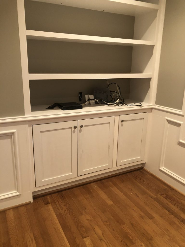 New cabinet doors installed. Closed cabinets provide storage solutions without looking cluttered