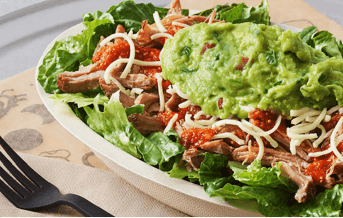 From Chipotle, try the Keto Bowl. It consists of romaine lettuce, carnitas, cheese, and guacamole.