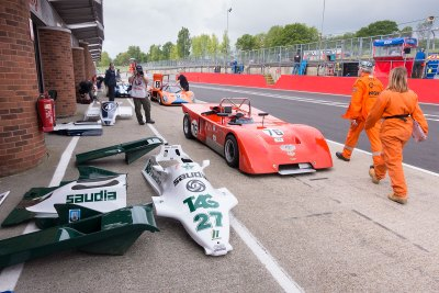 Pit lane vie with Chevron B19 1971 and Williams F1 cowling in foreground