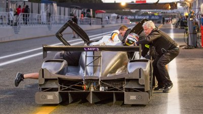 Driver boards LMP3 car during pit stop