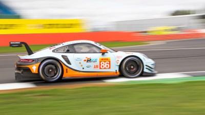 Gulf Racing Porsche 911 RSR takes a corner at speed, Friday practice, Silverstone 2018