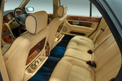 Rear cabin view showing seating and drinks compartment in a 2006 Bentley Arnage