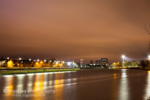 The Lagan River that runs through the middle of Belfast on a blustery, cold winters night.