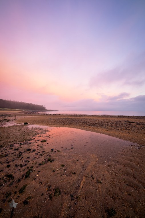 Here's a shot I took this week at Crawfordsburn Beach. It was a frosty and overcast morning, but the sun cutting through the clouds gave amazing colour in the sky.