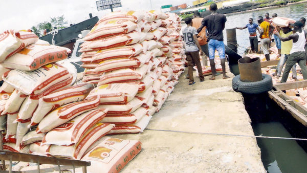 Customs arrests smugglers re-bagging 900 foreign rice as local