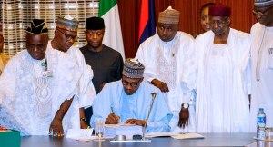 Buhari Signs 2018 Budget