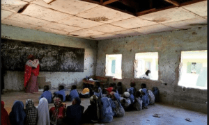Student sitting on the floor in a school in Bauchi