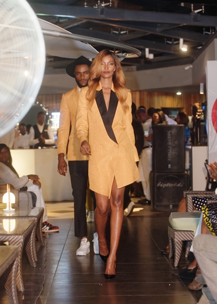 Millen Megaes in McMeka leads the models out onto the runway
