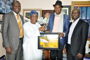 "Managing Director/Chief Executive, Med-View Airlines, Alhaji  Muneer Bankole, (2nd left) receiving the  ""Aviation Personality of the year 2016 Nigeria, award (Balafon Award) at the 2nd Weizo travel and tour conference and exhibition in Accra, Ghana from the Organiser, Mr. Ikechi  Uko, (3rd left).  Others from left, Executive Director, Technical, Med-View Airline, Engr. Lookman Animashaun and far right, Executive Director, Business Development, Med-View Airlines, Alhaji Isiaq Na'Allah."