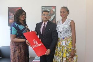 Regional Manager West Africa, Emirates Airline, Mr Manoj Nair (Middle), presenting an Air ticket to the President, Fashion Designers Association of Nigeria (FADAN), Mrs Funmi Ladipo at the Emirates Office; With them is a FADAN member Mrs Adaku Nwoko
