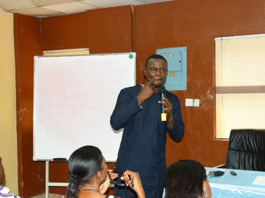 Mr Debo speaking at the monthly seminar