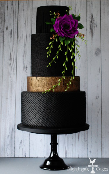 Black wedding cake with purple flower