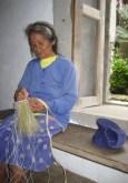 Preparing palm fibres for traditional raincoat