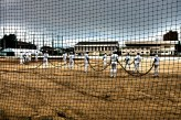 Higashi High baseball team hosing down a contaminated field.