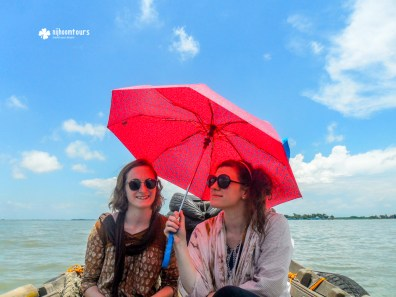 Ms. Elizabeth Wong and friend from UK on boat at Meghna