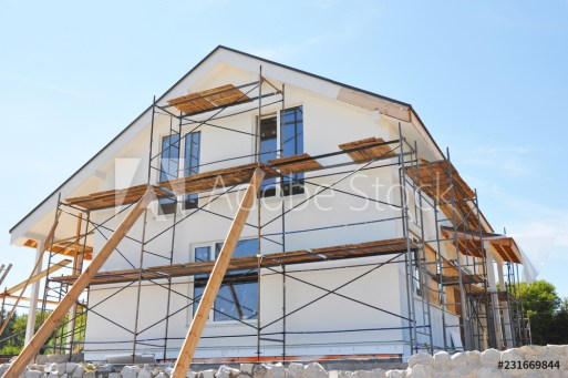 Painting, insulatin and plastering facade house walls after home renovation and remodel