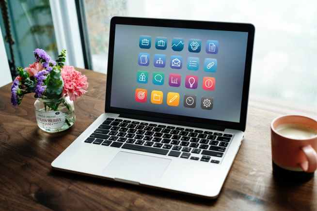 macbook on brown surface