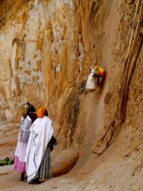 Women sending offerings to the priests