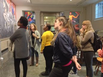 """Sarah Powers leads tour of José Clemente Orozco murals, """"The Epic of American Civilization"""" at Dartmouth. Fall 2014."""