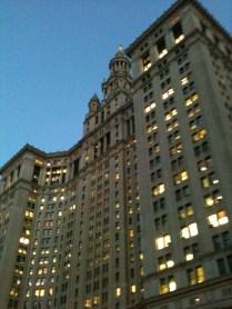 Manhattan Municipal Building at dusk.