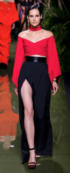 BALMAIN The subtle and chic look offers voluminous sleeves and an ankle length draped skirt but offers teases of leg, waist and shoulders bringing a sexy vibe to the design.