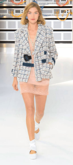 """CHANEL """"The bouclé-suited bots were a hint at what was to come"""" as Karl Lagerfeld aimed to transcend the traditional lady's look with age putting an 80s twist on Chanel's signature tweed suit."""