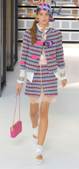 """CHANEL Tweed suits are everywhere in just about every color combination - subtle traditional blends to brighter hues featuring hot pink velvet straps - layering lacy underskirts and slip dresses. The runway designs """"all referred back to their original influence - the Chanel Suit 1.0"""""""