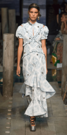 """ERDEM Inspired by a historical romance, Moralioglu added slits to the shoulders and waists of his fit-and-flare day dresses for subtle """"peekaboo"""" elements, in addition to the pretty prints."""