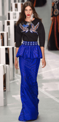 MARY KATRANTZOU The Greek inspired designs featured a peplum ballgown skirt and an embellished three-quarter sleeve black top with sequin doves outlining a mesh-like see-through effect, resulting in sexy chic evening wear.