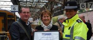 Roseanna Cunningham MSP and Nil by Mouth Campaign Director Dave Scott present BTP Area Commander Ellie Bird with the award.