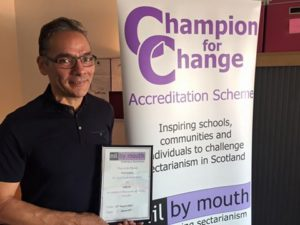 Paul receives his plaque at Nil by Mouth HQ