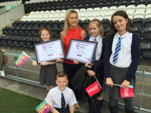 Karla Berry from the Ruby Trust presents pupils from West & St Mary's Primary Schools with their Champions for Change awards after working together on the Buddies programme