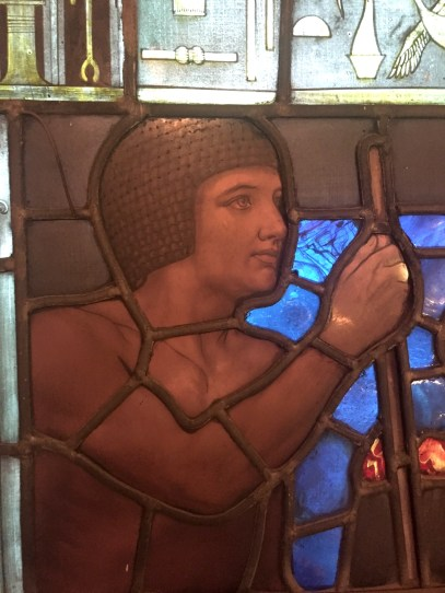 Old Kingdom wigs on the stained glass window
