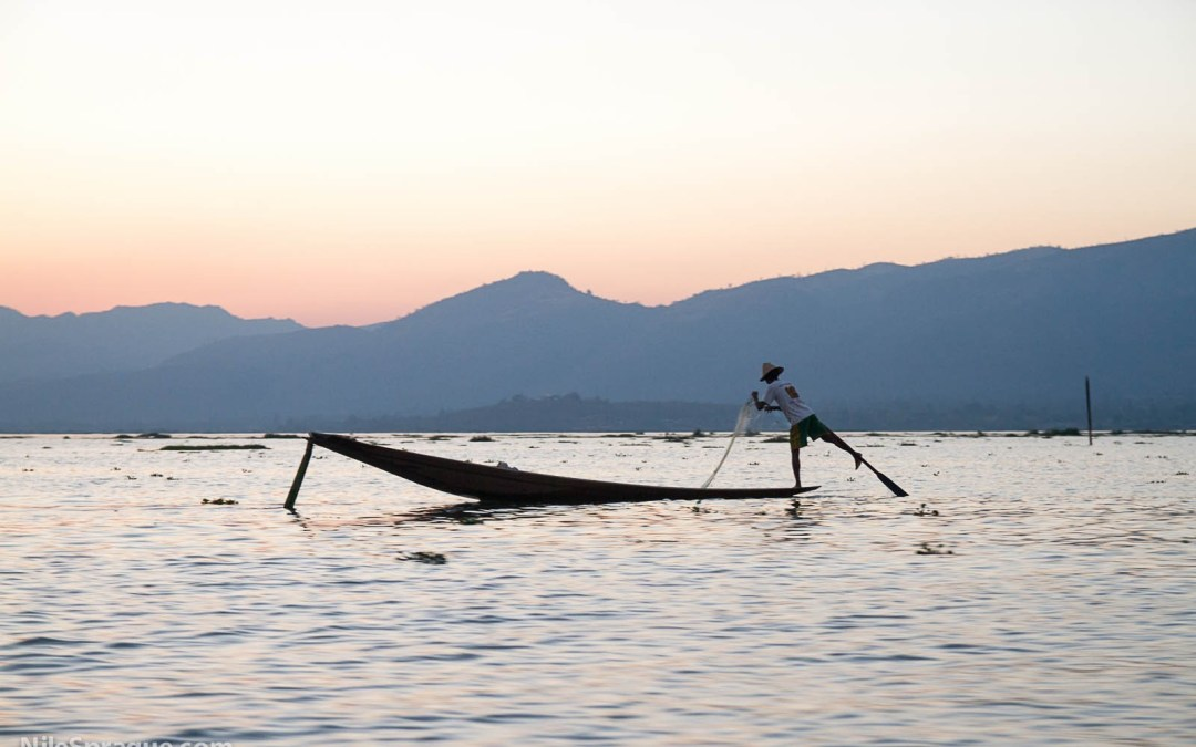 Photo: Intha fisherman paddling with his leg, Inle Lake, Shan State, Myanmar