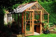 A simple wood look greenhouse from BC Greenhouses.