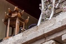 Still life with bird and lantern