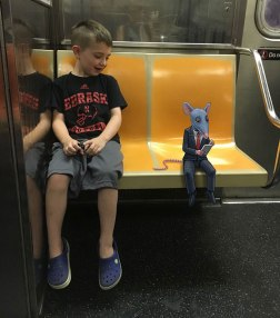 artist-adds-monsters-next-to-strangers-on-the-subway-03