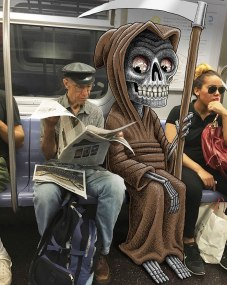 artist-adds-monsters-next-to-strangers-on-the-subway-16