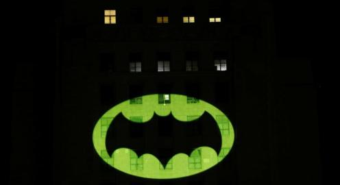 A bat-signal is projected on City Hall in honor of late actor Adam West in Los Angeles