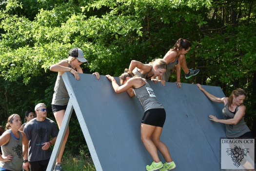 Scaling a wall at the DragonOCR mud run