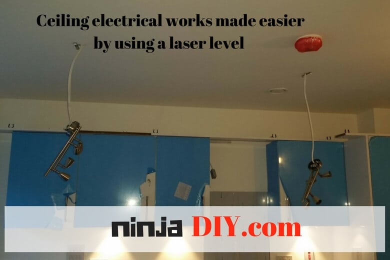 hanging ceiling accessories using a laser level makes electricians jobs easier